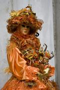 orange costume and mask, carnevale di venezia, carneval in venice, italy - stock photo