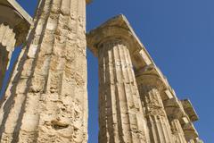 columns against a blue sky, tempel e (temple of hera), selinunte, sicily, ita - stock photo