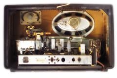 Inside of an antique radio, speaker wires and capacitor Stock Photos