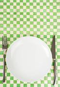 Stock Photo of empty dish, knife and fork