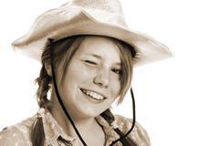 Teenage girl wearing cowboy hat Stock Photos