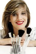 young woman, makeup brushes - stock photo