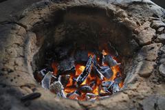 Simple earthen stove with glowing charcoal, amazon basin, brazil Stock Photos
