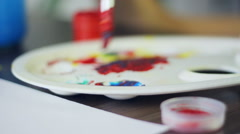 Mixing colors in the palette, art, culture, camera movement - stock footage