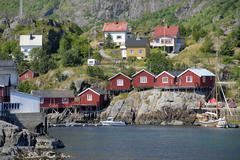 "Stock Photo of red wooden ""rorbu"" houses on a rocky shore, å, lofoten archipelago, norway,"