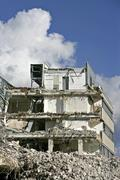 building in the process of being torn down, debris - stock photo