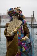 Colourful brown costume, mask and fan, carnevale di venezia, carneval in veni Stock Photos