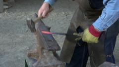 Blacksmith hammering steel red hot HD 134 Stock Footage