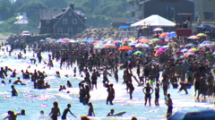 Crowded beach compression shot Stock Footage