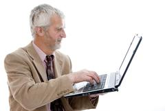 60+ retiree, senior working on laptop Stock Photos