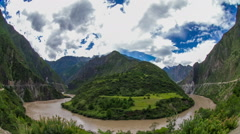 Cloudscape over a turbulent-wave river through mountain area. Stock Footage