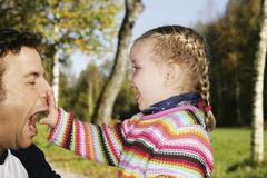 Father and his three-year-old daughter clowning around Stock Photos