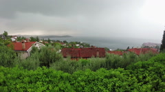 Lightning and thunderstorm above sea bay in daylight, panoramic view. Stock Footage