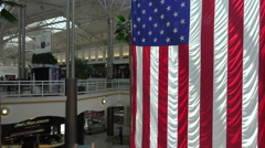 American USA flag in modern shopping mall HD 123 Stock Footage