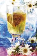 Stock Photo of chamomile tea with german chamomile (camomile) flowers (matricariae flos)