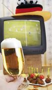 Stock Photo of retro football broadcast - tv broadcast of a game, football hat, tray of skew
