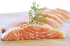 salmon filets garnished with dill - stock photo