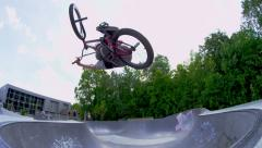 BMXer does big air trick on a skatepark ramp Stock Footage
