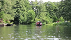 Boat trip by channel of Spreewald the German Venice Stock Footage