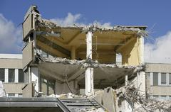 building in the process of being torn down - stock photo