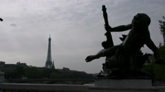 Paris Eiffel Tower from Paris Pont Alexandre III Statue with dramatic pose 4k Stock Footage