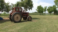 Tractor in irrigation field Stock Footage