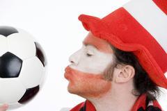 Austrian football supporter (soccer fan) kissing a football Kuvituskuvat