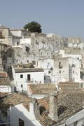 Stock Photo of white houses in the historic centre of monte s. angelo, apulia, italy