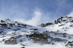 strong wind gusts and high drifts during a foehn (chinook) storm, mt. glungez - stock photo