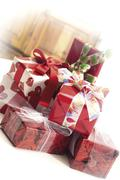 Presents wrapped in red gift-wrap and bows Stock Photos
