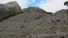 Tourists visiting Inka´s House Machu Picchu, Peru - UNESCO World Heritage Site Stock Footage