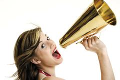 young woman screaming through a megaphone - stock photo