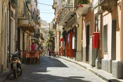 shops along a narrow street in the village of pizzo, calabria, southern italy - stock photo