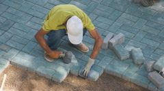 Chinese worker maintaining sett Stock Footage