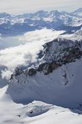 Stock Photo of view over an alpine valley enshrouded in mist, rofan range, zillertal alps, t