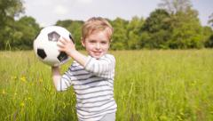 Little Boy Playing With Soccer Ball Stock Footage