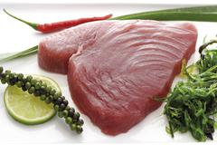 Raw tuna with algae, lime slice, green pepper and leek Stock Photos