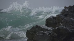 Powerful wave crashed into a rock close-up Stock Footage