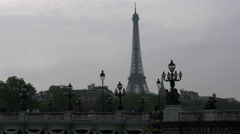 Paris Eiffel Tower from Paris Pont Alexandre III with lamp post and grey sky Stock Footage
