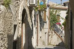 narrow alley between old stone buildings in gerace, calabria, southern italy - stock photo