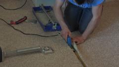 Carpet layer man working on floor 4K Stock Footage