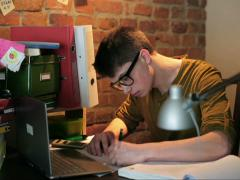 Student finishing homework on laptop Stock Footage