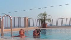 Baby holds at the edge of pool 2 Stock Footage