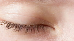 female teen eye close up, open and blinking - stock footage
