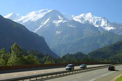 traffic on the highway in front of mount mont blanc autoroute blanche e25 a40 - stock photo