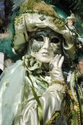 portrait, green mask at carneval in venice, italy - stock photo