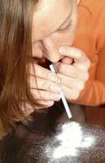 Woman takes cocaine Stock Photos