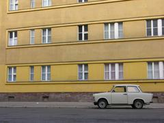 Paring east german car (trabi) on rosa-luxemburg-street in berlin, germany Stock Photos