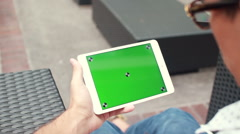 Man Holding Blank Tablet PC With Green Screen For Custom Content - stock footage