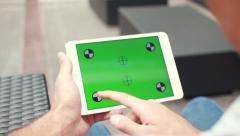 Man Swiping Tablet Touch Screen With Green Screen - stock footage